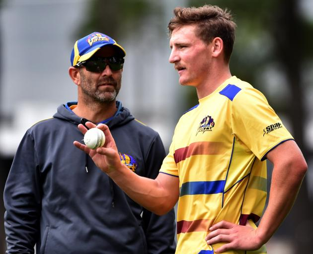 Otago Volts coach Rob Walter, seen here with Volts player Nathan Smith, is to continue in the...