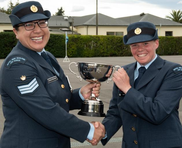 Aircraftman Sophie Aitken (right), of Queenstown, receives the Andrea McNabb Perseverance Cup...
