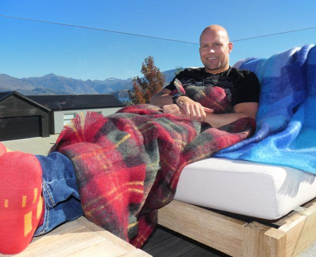Beating the chill  with mohair throws and socks designed locally is Steven Hobson. PHOTO: SIMON...