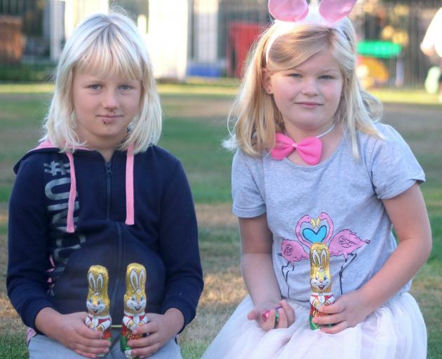 Kakanui School pupils Tilly McKnight (left) and Kate Ransby(both 7) hold some of the Easter treats left by the mysterious Kakanui Easter bunny on Thursday. PHOTO: KAYLA HODGE