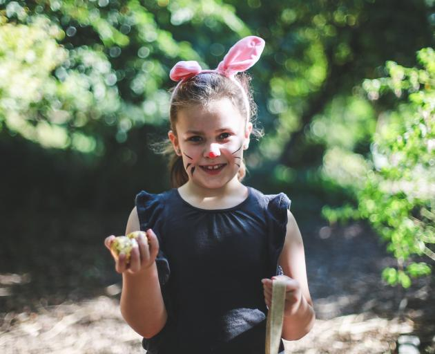 Olivia Hirst (6) holds up her haul of three Easter eggs at Oamaru Elim Church's annual Giant...