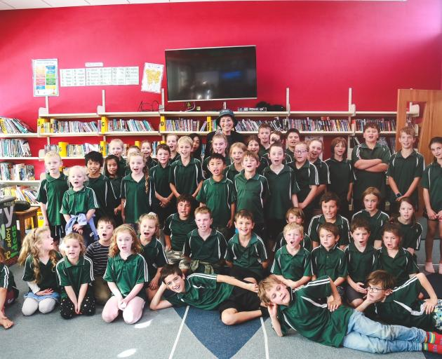 Waikaka School pupils say goodbye at her farewell function yesterday. Photo: Rebecca Ryan
