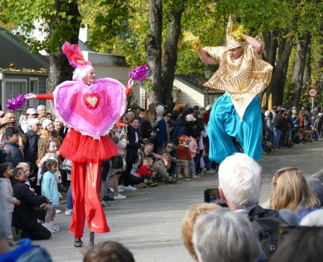 Stilt walkers entertain the thousands of people who gathered on Saturday for the 36th Arrowtown...