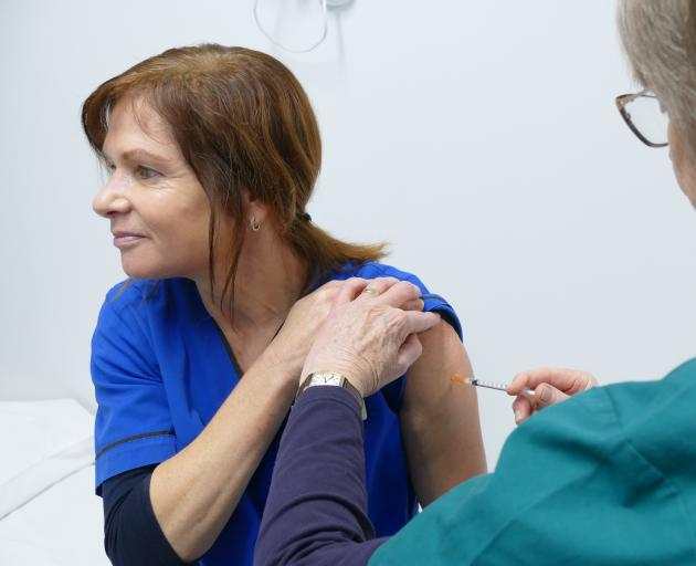 Queenstown Medical Centre nurse Suzie Hilton receives her first Covid-19 vaccination from...