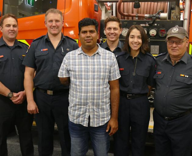 Lochana Kulasiri (centre), of Queenstown, pictured with some of the volunteer firefighters who...