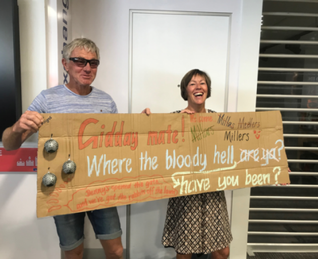 Friends and family of those on the flight into Queenstown are waiting with signs in the arrivals lounge. Photo: RNZ