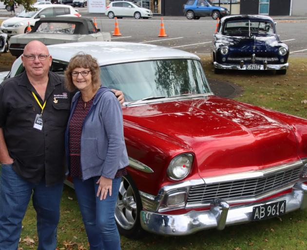 Gore woman Elaine Scott chats with John Eisenhut, who now co-owns the 1956 Chevrolet Bel Air in...
