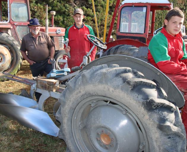 Dave McDonald of Gore has been teaching his grandsons, Flynn (left) and Riley, how to plough and...