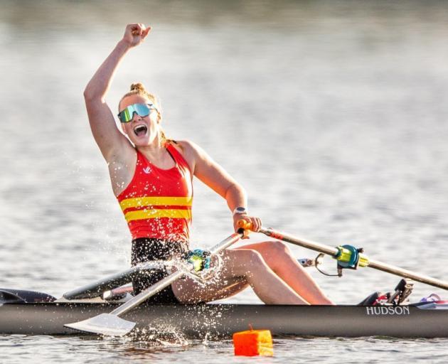 Big splash . . . Dunstan High School's Sophie Smith celebrates winning gold in the under-18 girls...