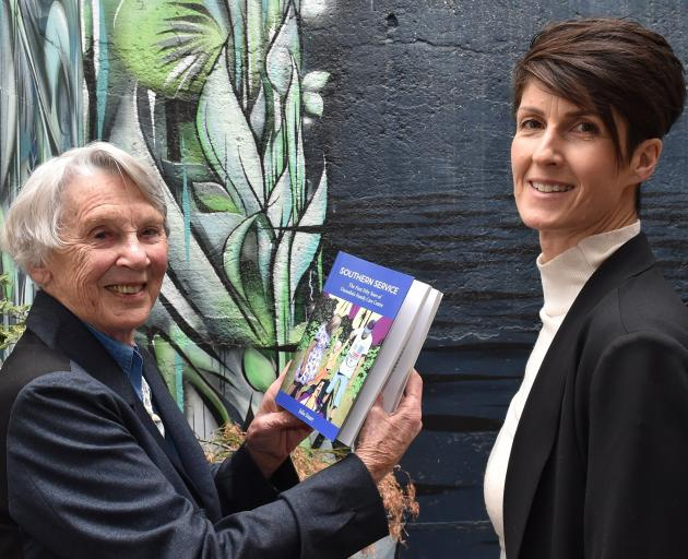 Julia Stuart shows her book Southern Service, which documents the history of Anglican Family Care...