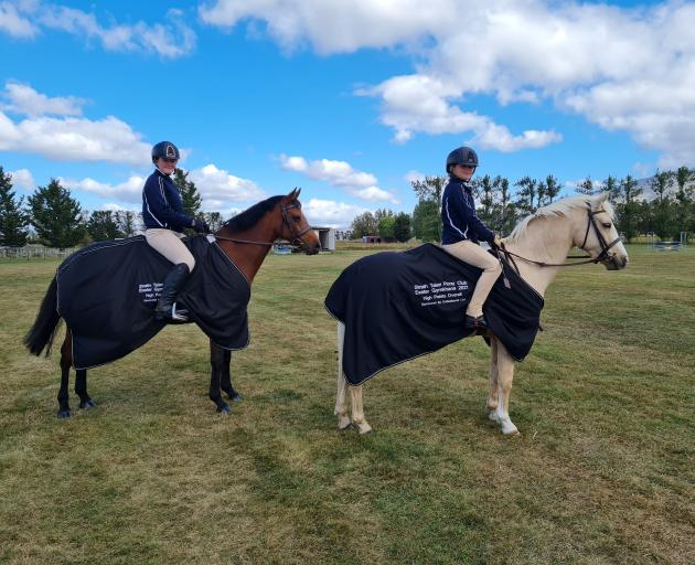 Strath Taieri Pony Club members Sarah Hay (16, left) rides Beechcroft Le Dance and Neave O...