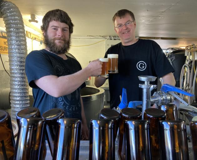 Catlins Brewery co-owner Norm Macleod with apprentice brewer Jeff Bray, on work placement from...