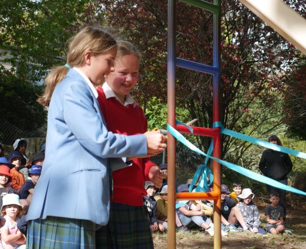 Former Balaclava School pupils Bonnie Wilson (left) and Gretel Calvert (both 11) cut a ribbon on...