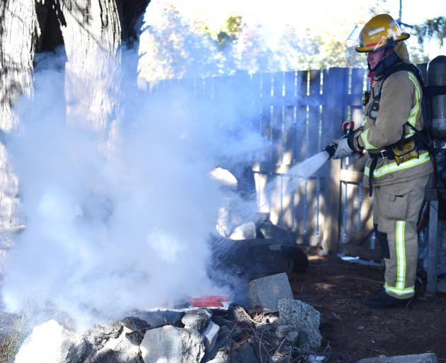 Fire and Emergency New Zealand Qualified Firefighter Tim Dickey, of Dunedin City Fire Station,...