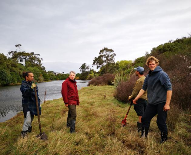 Getting stuck in to the riparian planting are (from left) Dennis Kahui, Andy Hutcheon, Heath...