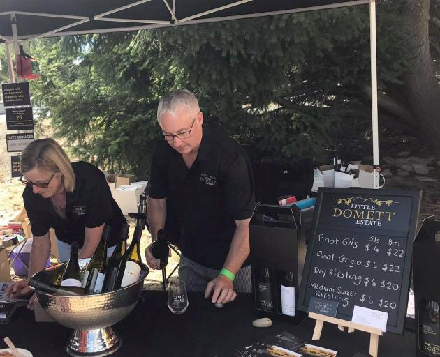 Marg Eton-Marsh and Gary Marsh serve their wines at the Twizel Salmon and Wine Festival in...