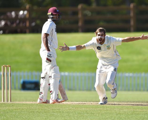 Otago wrist spinner Michael Rippon celebrates the wicket of Northern Districts batsman Brett...