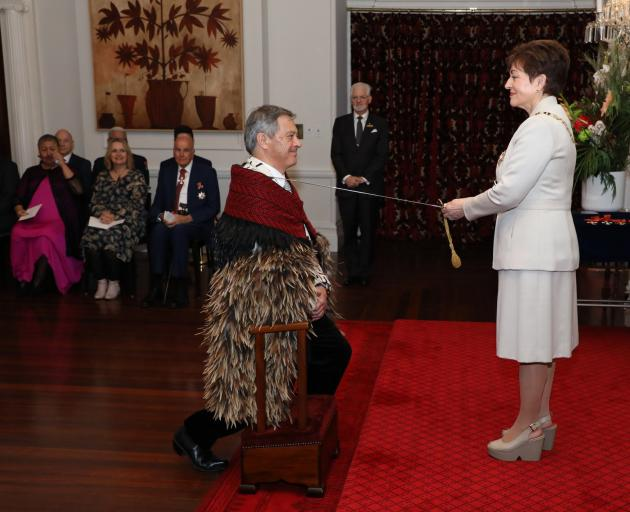 Dame Patsy knights Sir Ian at Government House yesterday. PHOTO: DOUG MOUNTAIN/Government House