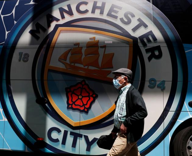 A man walks past the Manchester City team bus in Porto, Portugal, yesterday ahead of the...