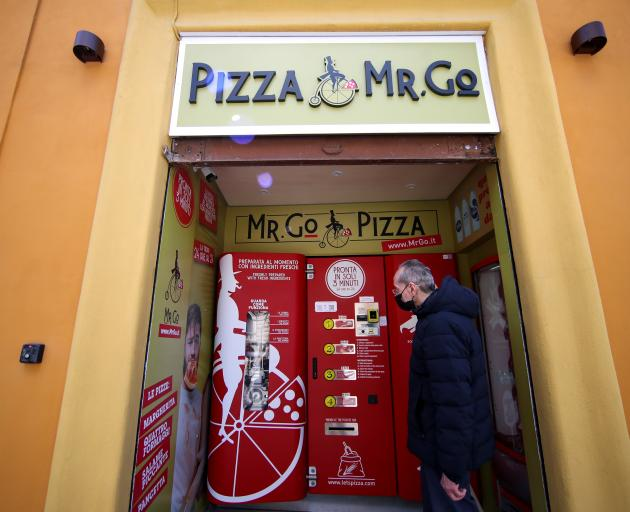 The first automatic pizza vending machine installed in the capital. Photo: Reuters