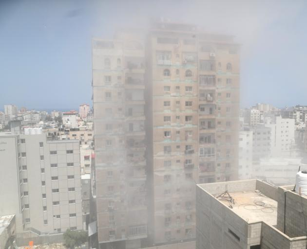 Dust and smoke rise following an Israeli air strike amid a flare-up of Israeli-Palestinian...