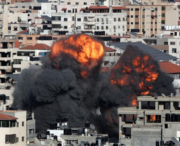 Smoke and flames rise during an Israeli air strike, amid a flare-up of Israeli-Palestinian violence, in Gaza City. Photo: Reuters