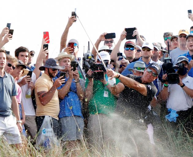 Phil Mickelson hits out of the rough on the sixteenth course during the third round of the PGA...