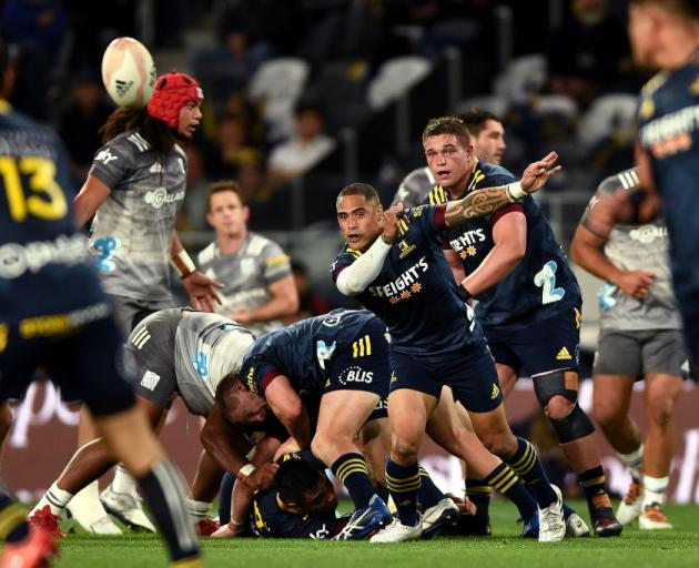Highlanders halfback Aaron Smith clears the ball from a ruck against the Chiefs at Forsyth Barr...