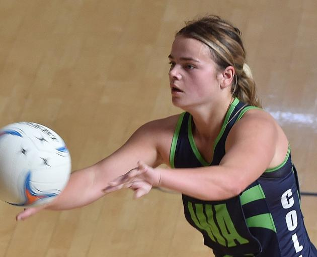 College A wing attack Abby Johnston looks to move the ball on against South Pacific Titans A at...