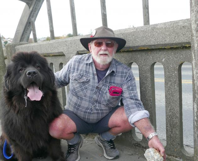 Graeme Blackmore, of Balclutha, holds a chunk of concrete from the Balclutha Bridge, which he...