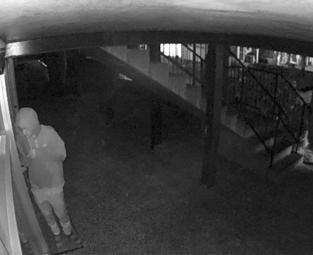 CCTV footage of an intruder attempting a break-in captured on a neighbour's  security camera,...