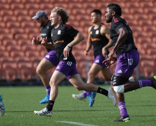 Damian McKenzie (centre) warms up during a Chiefs training session yesterday. Photo: Getty Images