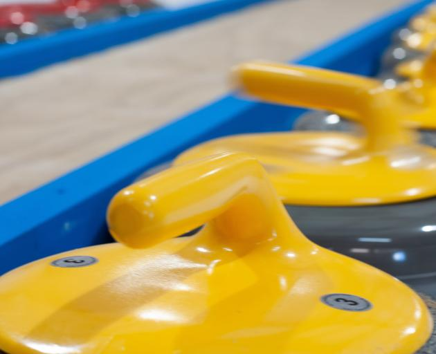 Brand new curling stones sit ready to use at the rink