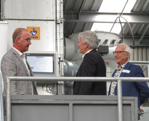 Vincent Luisetti (left) chats to Damien O'Connor and Max Luisetti during the official opening of...