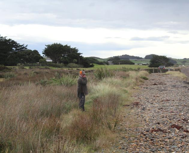 Alan McKay stands in the site of an old tip, located just metres from the crumbling road. Right:...