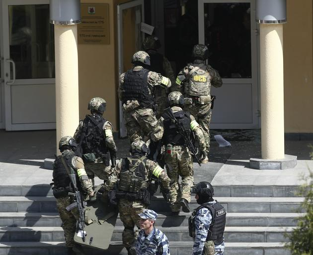 FSB officers enter the school where the attack took place. Photo: Getty Images