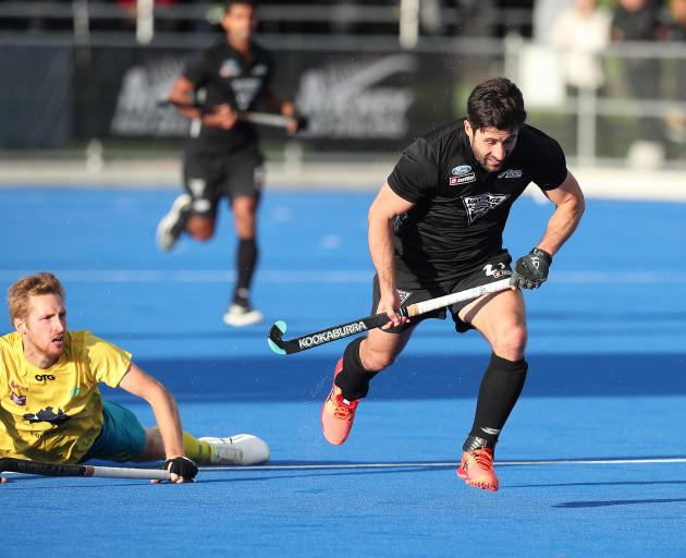 Daniel Beale of Australia challenges Kane Russell of New Zealand during the Trans-Tasman Series...