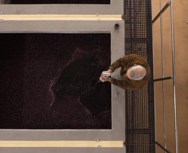 Gordon Russell plunges the grapes in one of Esk Valley's concrete  vats.  PHOTOS: SUPPLIED