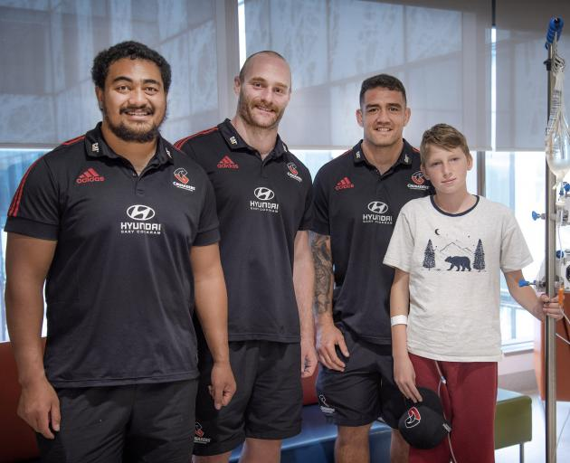 Isi Tu'ungafasi, Oliver Jager and Codie Taylor with a young patient. Photo: Supplied