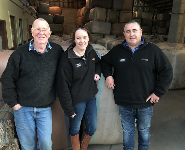 Jim Paterson (left), from wool buyer Brian Redding Ltd, and new owners Annie and Bede Chamberlain...