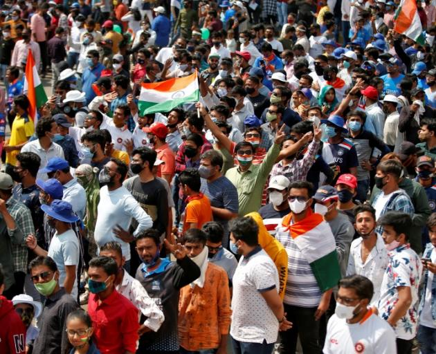 Fans line up to attend an IPL game earlier this year. Photo: Getty Images
