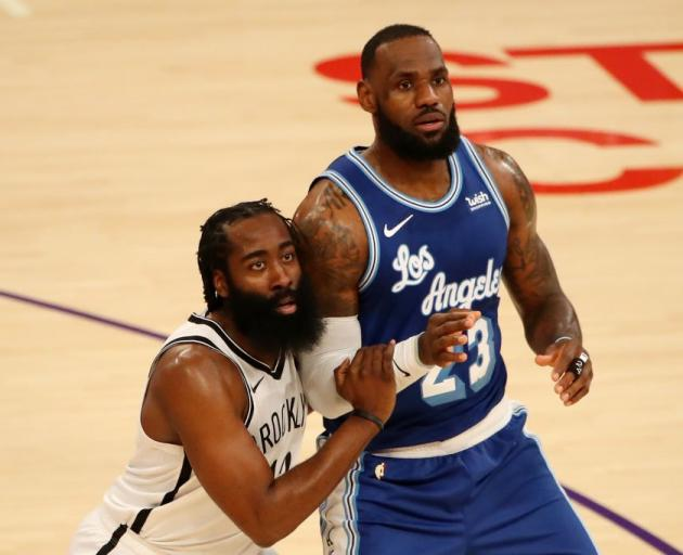 James Harden (left) and LeBron James may go to battle if the Brooklyn Nets and Los Angeles Lakers...