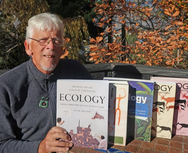 Emeritus Prof Colin Townsend, of Wanaka, with the newly published fifth edition of his book...