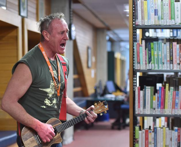 Michael Wingfield (also known as Kathartipuss) makes some noise at the library.