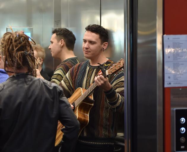 Dane Oates performs in a lift at the Dunedin City Library as part of the Nook and Cranny Music...