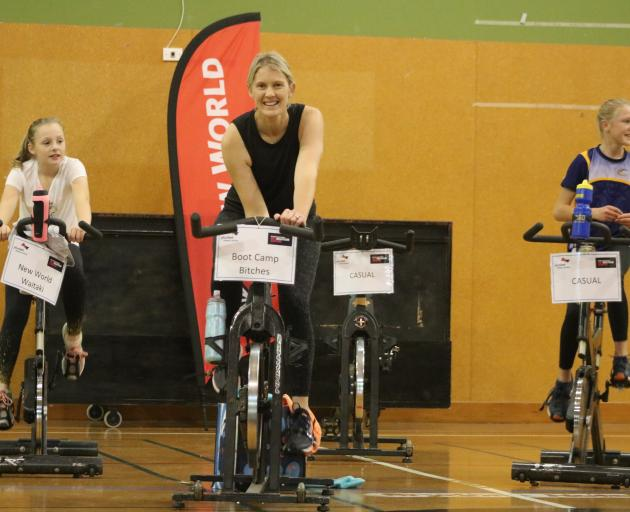 Kate Webster rides in the North Otago Plunket ''Lycra for Littlies'' spin-a-thon flanked by her...