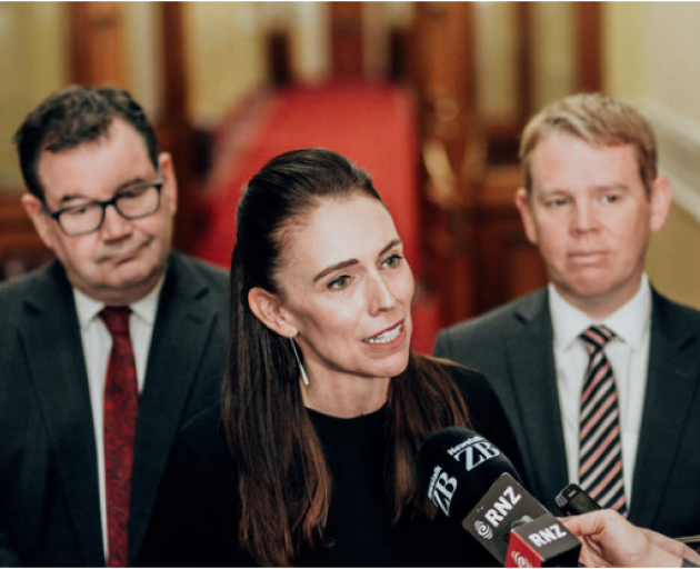 Jacinda Ardern flanked by Grant Robertson, left, and Chris Hipkins, right. Photo: RNZ