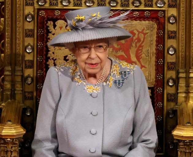 The Queen wore a day dress instead of the usual robes and crown for the State Opening of...