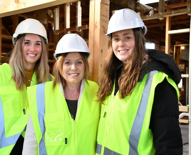 Della-May, Melissa and Lilly Vining (14) at the Southland Charity Hospital building yesterday....