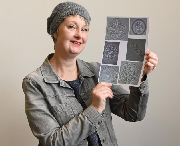 Stella Lange models the hat she designed for the Earth + Science  Project — ''Earth: Caught in...